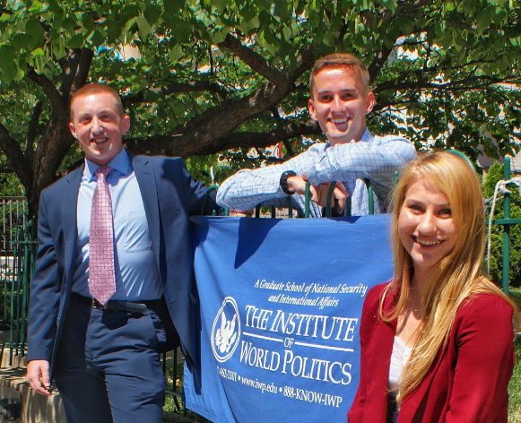Interns with IWP banner