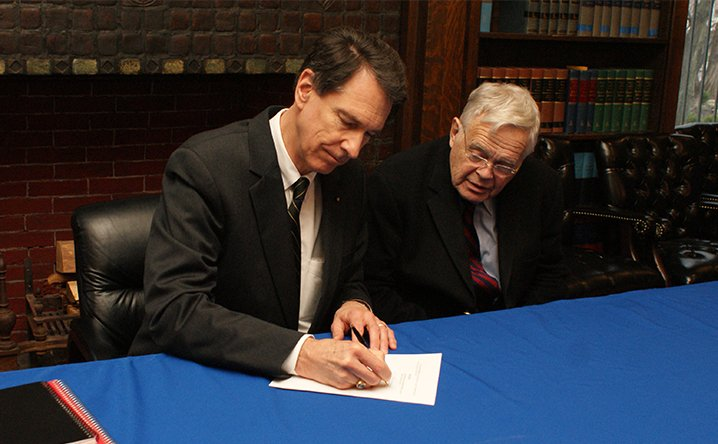 John Lenczowski and Owen Smith sign letter of intent to purchase the campus, January 2016
