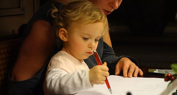 Child writing 380x204