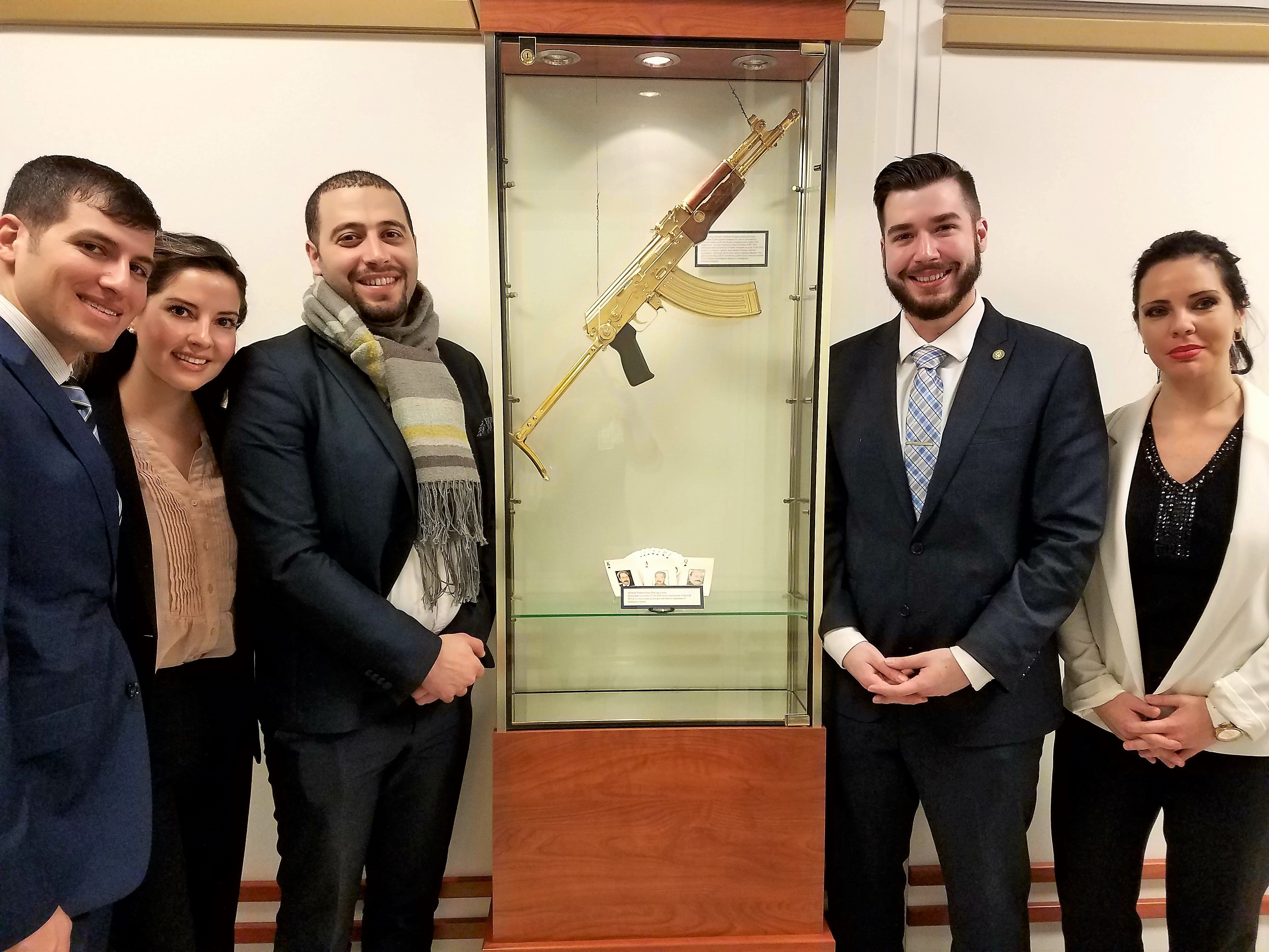 Student Ambassadors with Saddam Hussain's gold-plated Ak-47