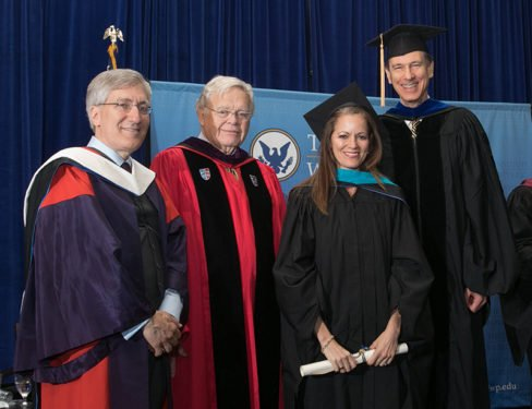 Jacqueline Halbig von Schleppenbach stands with IWP faculty members with her diploma in hand at commencement.