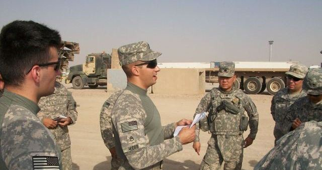 Chris Webb giving a convoy brief before a mission in Iraq