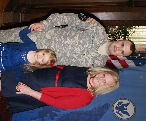 Major Aaron J. Kuykendall and his family, April 18, 2013
