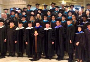 IWP graduates stand with their caps and gowns at the 2014 commencement ceremony.