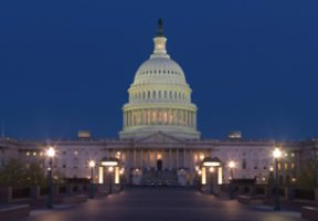 The U.S. Capitol is shown at night. The lights inside the building are on.