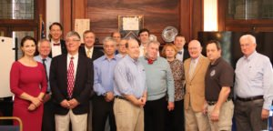 A group of IWP faculty members stand together at an event.