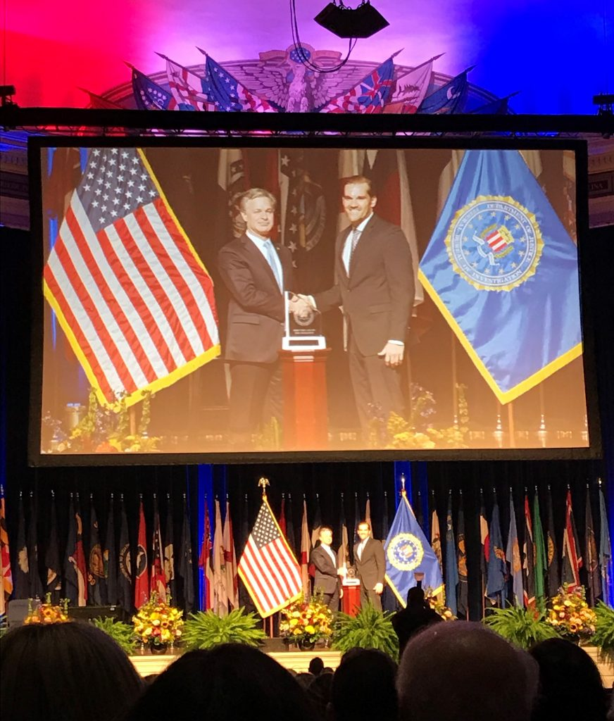 Tim B receiving FBI Director's Award for Excellence