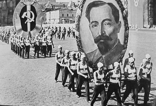 Portrait of Felix Dzerzhinsky in a Soviet Parade in Moscow, 1936, carried by athletes of the Dynamo Sports Society.